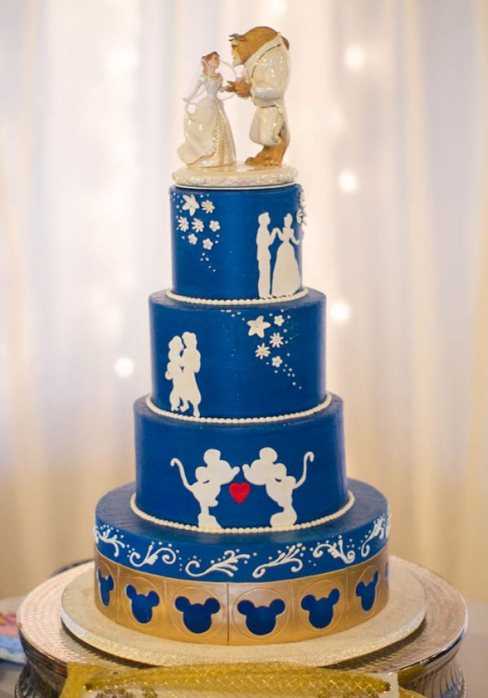 Blue and White Wedding Cake with Disney Silhouette Details and Beauty and the Beast Cake Topper